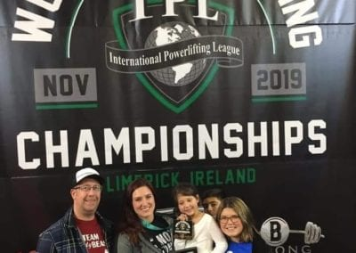 Dani with family and trophies